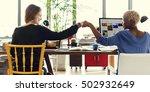 fist bump corporate colleagues... | Shutterstock . vector #502932649