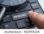 Stock photo job vacancy computer keyboard magnifying glass human resource business concept 502955224