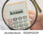 Small photo of account text displayed on calculator and magnifier. accounts, accounting and banking concept.