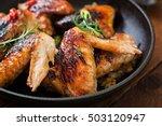 baked chicken wings in pan on... | Shutterstock . vector #503120947