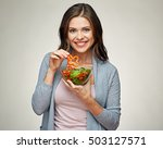 young smiling woman eating... | Shutterstock . vector #503127571