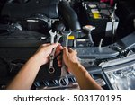 hand holding a wrench with a... | Shutterstock . vector #503170195