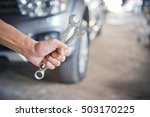 hand holding a wrench with a... | Shutterstock . vector #503170225