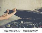 hands opening vehicle hood  car ... | Shutterstock . vector #503182609