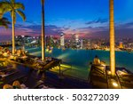 pool on roof and singapore city ... | Shutterstock . vector #503272039