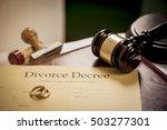divorce decree and wooden gavel    Shutterstock . vector #503277301