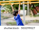 young asian boy hang the yellow ... | Shutterstock . vector #503299027
