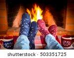 Couple In Christmas Socks Near...