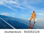 a man working on solar panels. | Shutterstock . vector #503352124