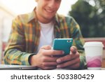 smiling man with smartphone in... | Shutterstock . vector #503380429