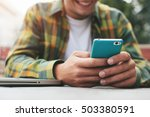 smiling man with smartphone in... | Shutterstock . vector #503380591