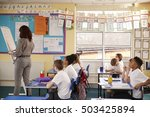 primary school teacher writing... | Shutterstock . vector #503425894