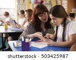 teacher helping schoolgirl... | Shutterstock . vector #503425987