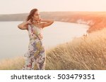 beautiful girl in meadow with... | Shutterstock . vector #503479351