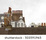Small photo of Autumnal London Skyline. On a gloomy overcast autumn day, the London skyline of chimneys and interesting attic spaces look all the more quaint.