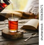Small photo of Herbal tea in glass cup in cozy ambience.