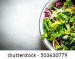 salad of fresh greens. on the...