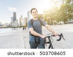 man walking carrying his bike... | Shutterstock . vector #503708605