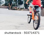 boy with bicycle in a skate park | Shutterstock . vector #503714371