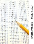 Small photo of Blue Scantron Bubble Test with number two yellow pencil.