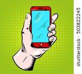 hand holding red smartphone... | Shutterstock .eps vector #503822245