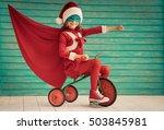 Superhero Child Rides A Bike....