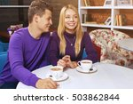 young man drinking coffee and... | Shutterstock . vector #503862844