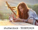 witch with crystal ball at... | Shutterstock . vector #503892424