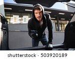 furious criminal man in hoodie...   Shutterstock . vector #503920189