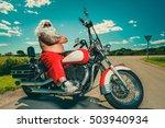 Sunburned Santa Biker Riding...