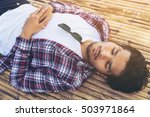 young man sleep on bamboo bed. | Shutterstock . vector #503971864