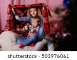 mom and son hid under a blanket | Shutterstock . vector #503976061