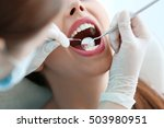 dentist examining patient's...   Shutterstock . vector #503980951