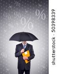 Businessman holding umbrella, illustrated rain made of percentage symbols. Share profit concept. - stock photo