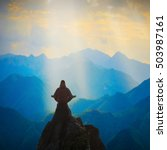 Small photo of Silhouette of man meditating in sitting yoga position on the top of mountain above the misty valley. Zen, meditation, peace