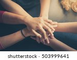 group of diverse hands together.... | Shutterstock . vector #503999641