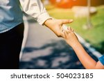 mother and son holding hands... | Shutterstock . vector #504023185