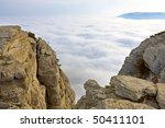 Nice mountain landscape over clouds - stock photo