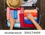 woman packing a luggage for a... | Shutterstock . vector #504174409