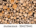 Closeup of logs of trees in nature. a lot of cutted logs. - stock photo