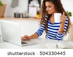 smiling young woman with coffee ... | Shutterstock . vector #504330445