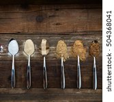 Small photo of Different Kinds of Sugar in the Spoons, such as coconut sugar, pure cane sugar, icing sugar, agave syrup, dark brown soft sugar, golden caster sugar, demerara cubes