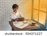 young businessmen sit across... | Shutterstock . vector #504371227