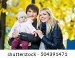 Cheerful Parents With Baby In...