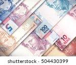 Different Money Bills Stacked...