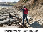 Man Taking Picture Of Fur Seal...