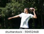 A Young Man Throwing A Footbal...
