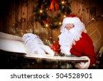 santa claus writing a magic... | Shutterstock . vector #504528901