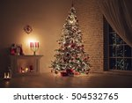 Stock photo feast of christmas beautifully decorated house with a christmas tree ipodarkami underneath 504532765