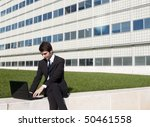 Young manager working outdoors the corporate garden - stock photo